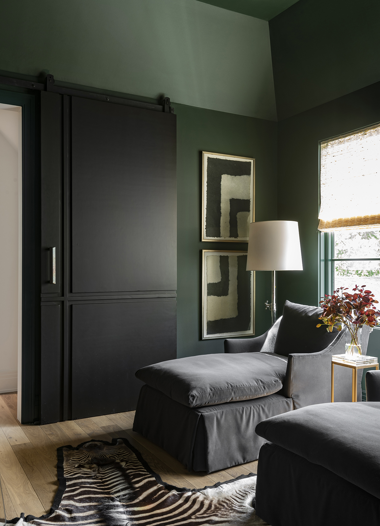 Forest green walls and black sliding doors to bedroom
