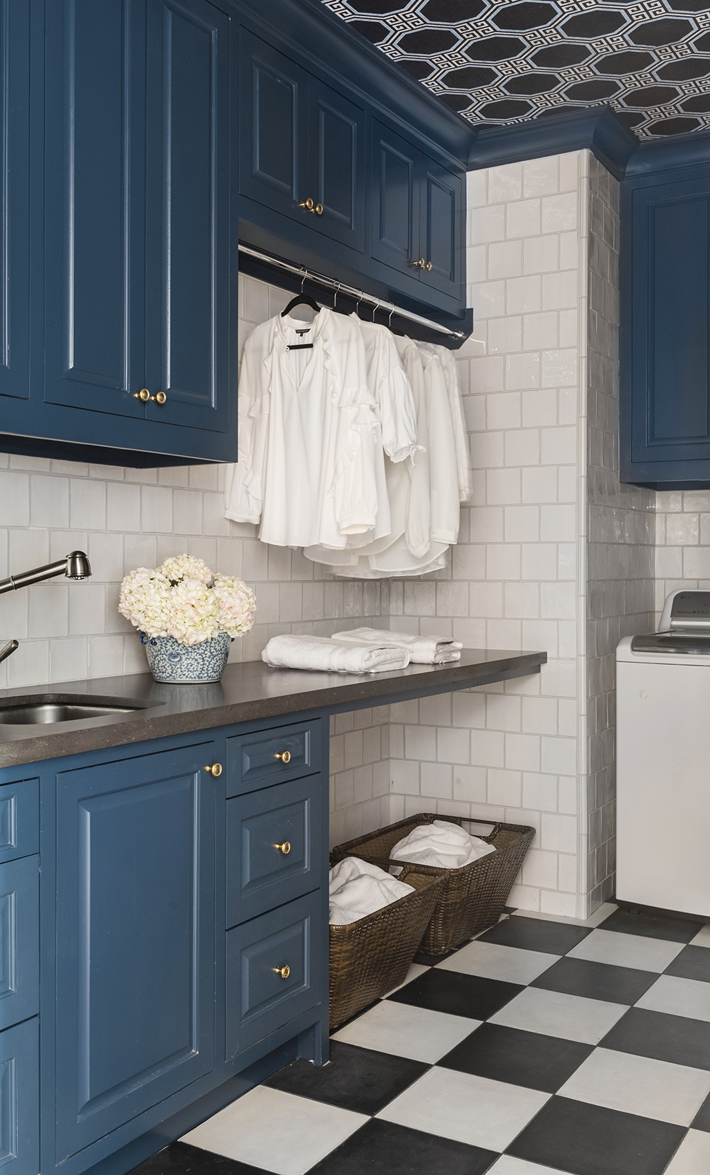 laundry room with blue cabinetry