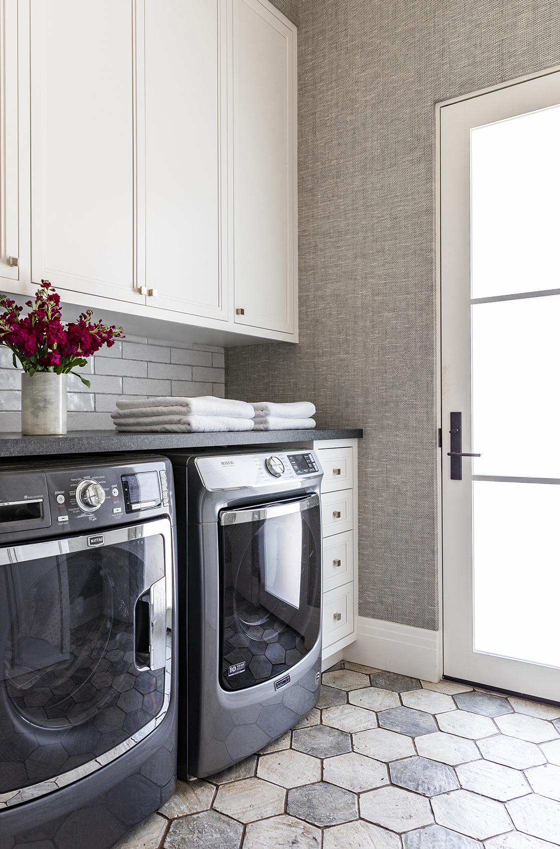 custom laundry room with tiled flooring