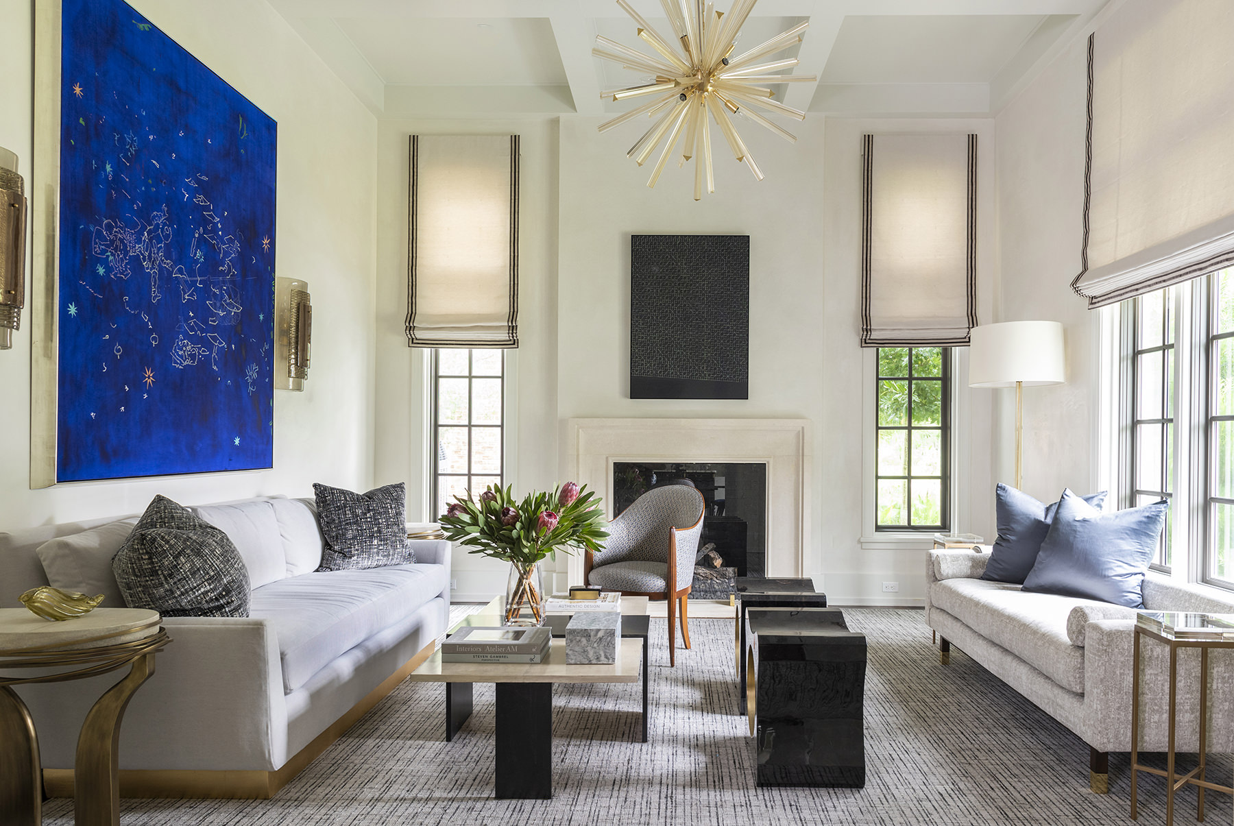 elegant living room space with curated paintings