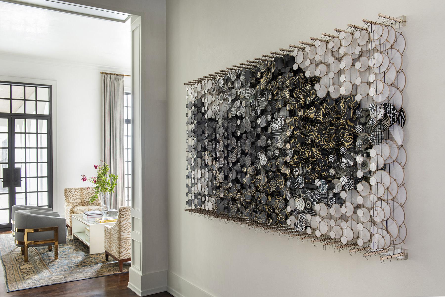 elegant black and white art piece in hallway