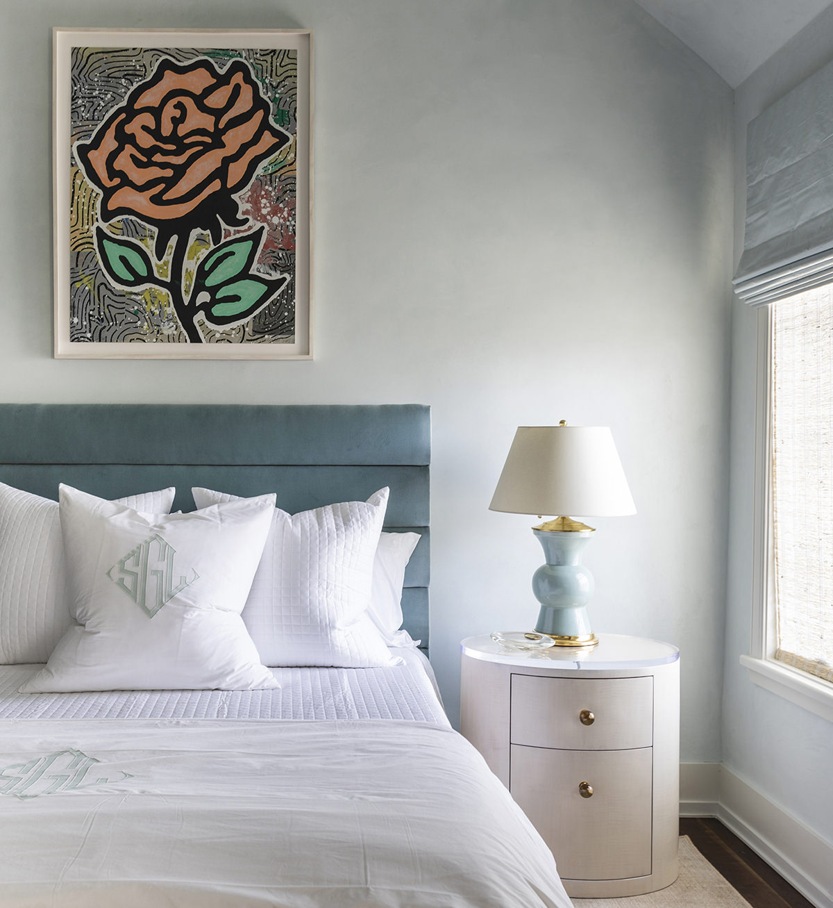 bedroom featuring rose artwork above bed