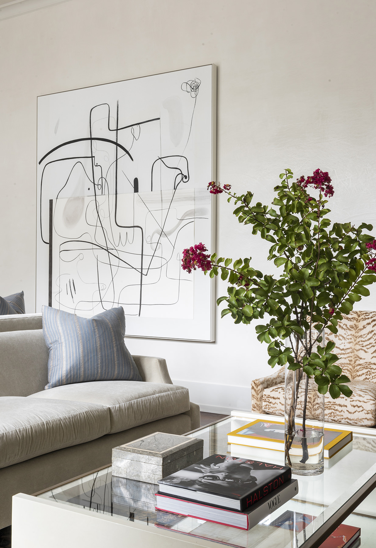 elegant living room featuring black and white contemporary art piece