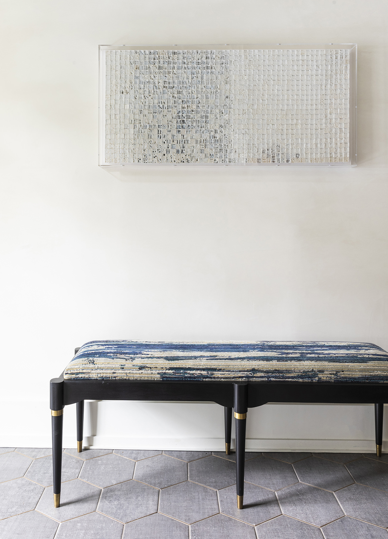 elegant padded bench in home entrance way