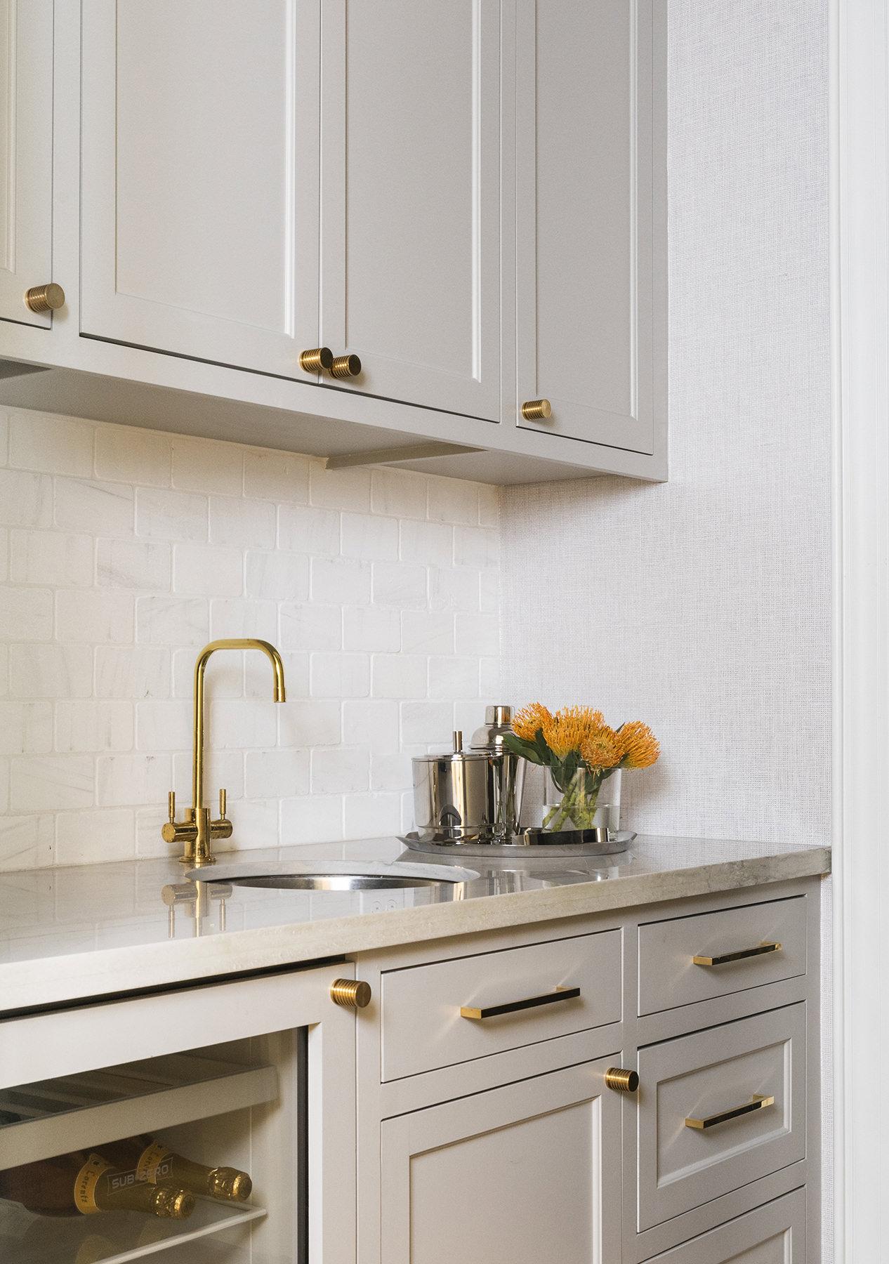kitchen sink with orange floral arrangement